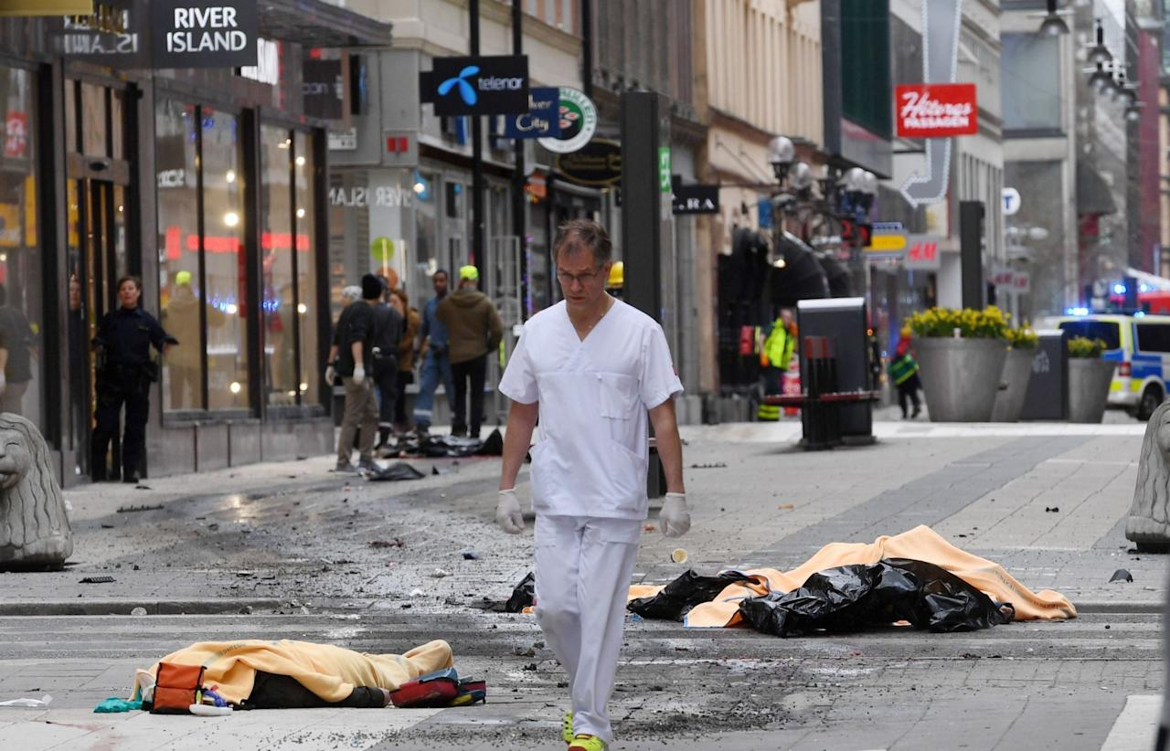 <p>A medical worker on the scene after the attack in central Stockholm (Rex) </p>