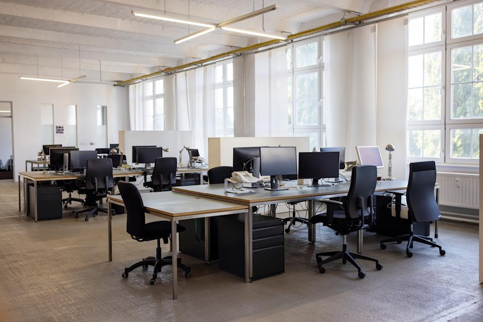 Open plan startup office. Coworking desks in a brightly lit office space.