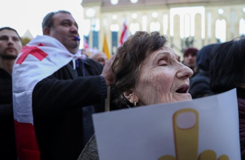Opposition supporters take part in a rally to protest against the government and demand an early parliamentary election in Tbilisi