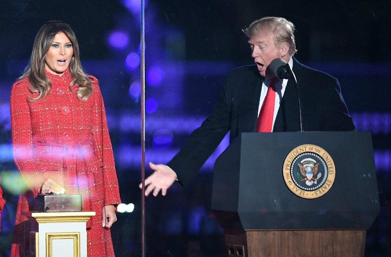 <p>President Donald Trump (R) gestures as first lady Melania Trump smiles during the 95th annual National Christmas Tree Lighting ceremony at the Ellipse in President's Park near the White House in Washington on Nov. 30, 2017. (Photo: Jim Watson/AFP/Getty Images) </p>