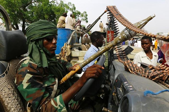 A fighter from the Sudanese Rapid Support Forces sits in an armed vehicle in Nyala, south Darfur, on May 3, 2015, displaying weapons purportedly captured from the Justice and Equality Movement (JEM) (AFP Photo/Ashraf Shazly)