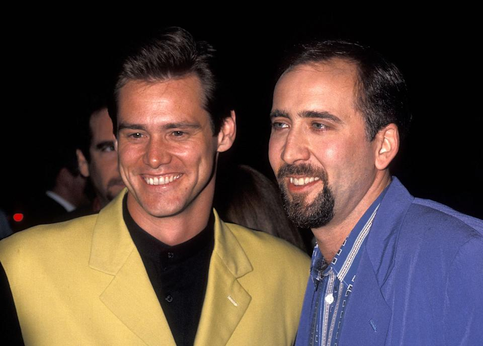 """Actor/Comedian Jim Carrey and actor Nicolas Cage attend the """"It Could Happen to You"""" New York City Premiere on July 26, 1994 at the Paris Theatre in New York City. (Photo by Ron Galella, Ltd./Ron Galella Collection via Getty Images)"""