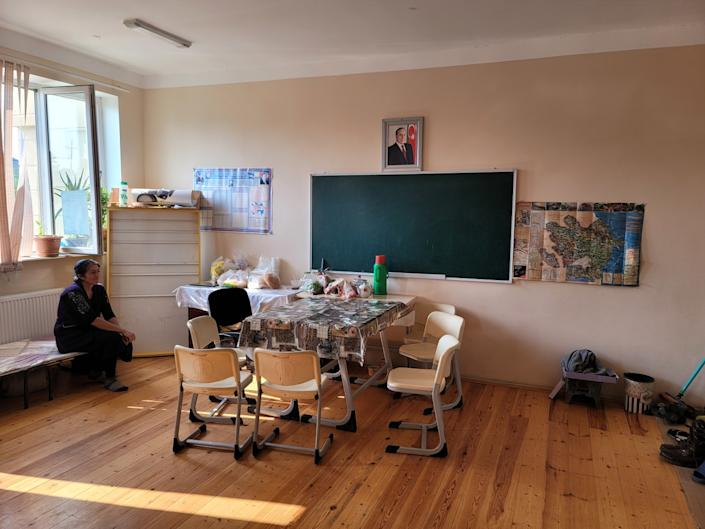 Yegana Ismailova, who fled Nagorno-Karabakh, sits in the classroom that is now her temporary home.