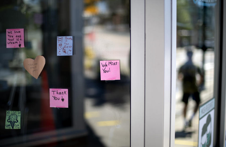 Notes from customers are posted on the window of one of two Brickley's Ice Cream shops which closed for the season after teenage workers were harassed by customers who refused to wear a mask or socially distance, in Wakefield, R.I., Wednesday, July 29, 2020. Disputes over masks and mask mandates are playing out at businesses, on public transportation and in public places across America and other nations. (AP Photo/David Goldman)
