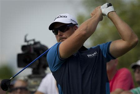 Henrik Stenson of Sweden watches his ball after hitting it during the first round of the DP World Tour Championship in Dubai