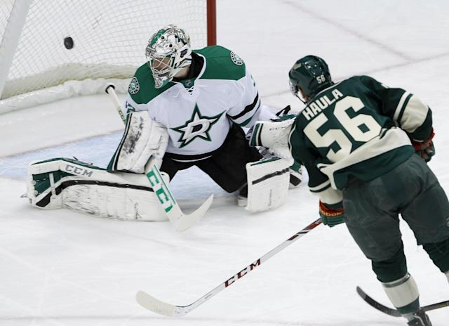 A shot by Minnesota Wild left wing Erik Haula (56), of Finland, gets past Dallas Stars goalie Kari Lehtonen, of Finland, for a goal during the first period of an NHL hockey game in St. Paul, Minn., Saturday, Jan. 18, 2014. (AP Photo/Ann Heisenfelt)