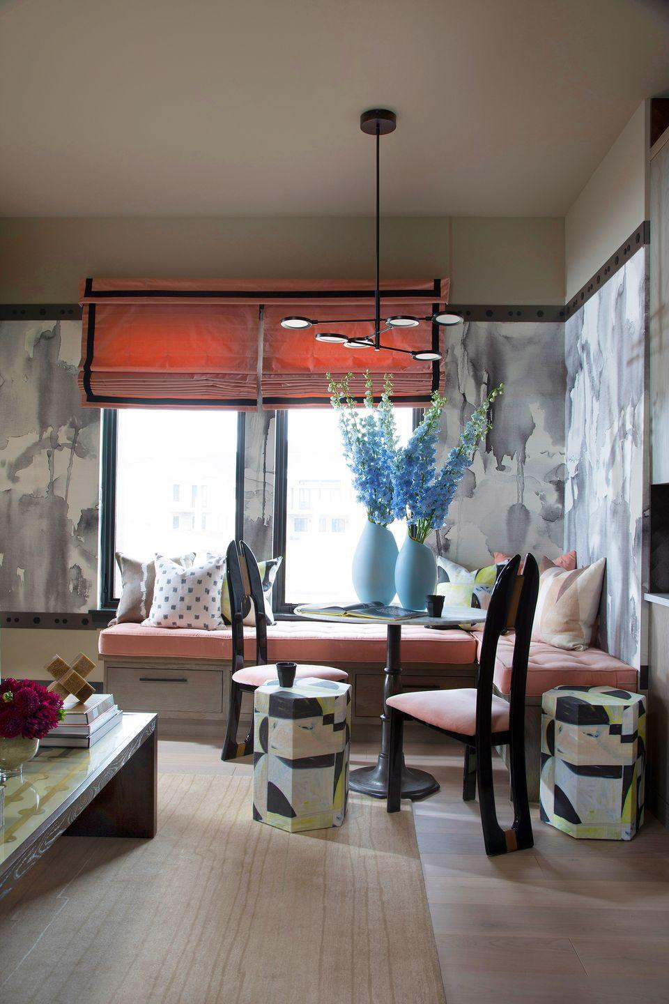 """<p>Designed by <a href=""""https://www.tiffanybrooksinteriors.com/"""" rel=""""nofollow noopener"""" target=""""_blank"""" data-ylk=""""slk:Tiffany Brooks"""" class=""""link rapid-noclick-resp"""">Tiffany Brooks</a> for the House Beautiful 202o Whole home concept, this nook carves out a place for guests to eat in their very own little apartment within the larger home. Pink upholstery on the banquette ties in nicely with the window treatments and accents throughout, like the chair cushions. </p>"""