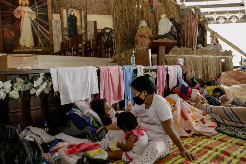 'All in God's hands': Volcano evacuees hunker down in Philippines