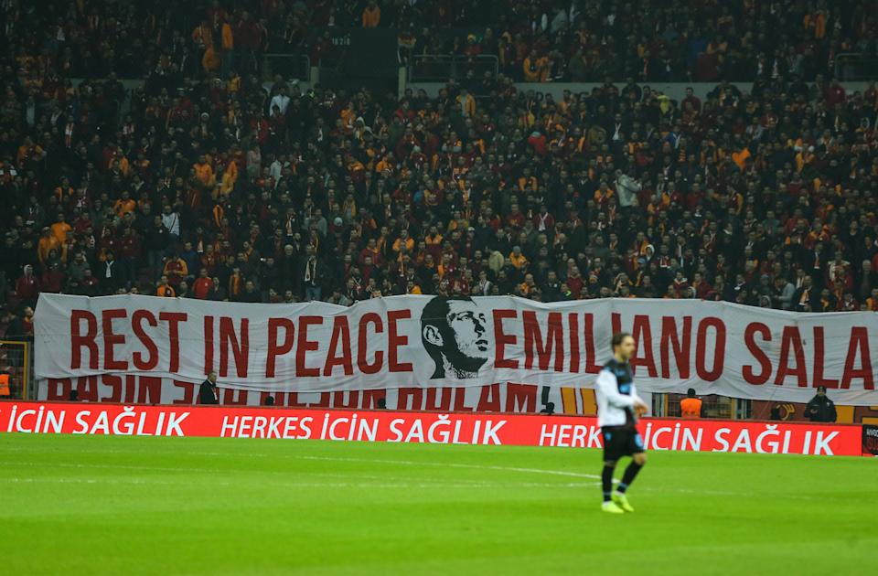 ISTANBUL, TURKEY - FEBRUARY 10: Galatasaray fans unfurl a banner to pay tribute to Cardiff City player Emiliano Sala following his death during Turkish Super Lig soccer match between Galatasaray and Trabzonspor at Turk Telekom Stadium in Istanbul, Turkey on February 10, 2019. (Photo by Salih Zeki Fazlioglu/Anadolu Agency/Getty Images)