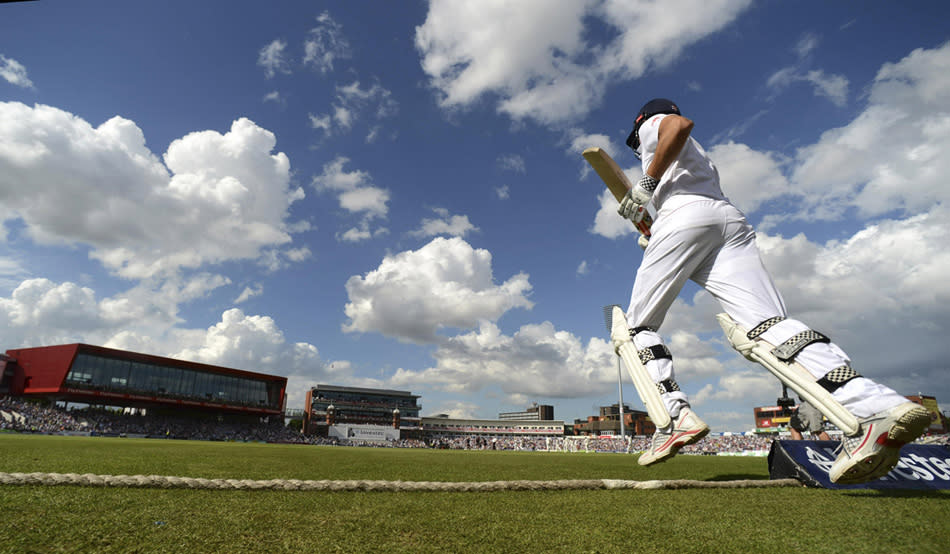 England's captain Alastair Cook runs on to the field to bat during the third Ashes cricket test match against Australia at Old Trafford cricket ground in Manchester August 2, 2013. REUTERS/Philip Brown (BRITAIN - Tags: SPORT CRICKET)