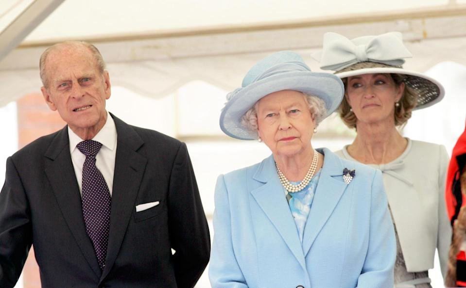 Britain's Queen Elizabeth II stand wwith the Duke of Edinburgh and Lady Brabourne, formerly Penny Romsey (right) outside Romsey Abbey, Hampshire, where she attended a service to mark the 400th anniversary of the market town's Royal Charter.   (Photo by Ian Jones - PA Images/PA Images via Getty Images)