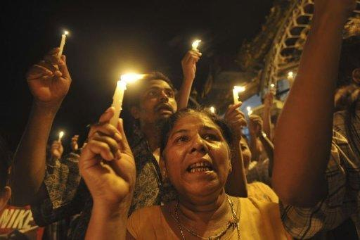 Myanmar demonstrators hold a candlelight protest at Sule pagoda