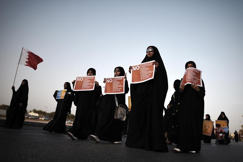 Bahraini women take part in an anti-government protest, in the village of Karranah, west of Manama, on August 8, 2014 after a Bahraini court stripped nine Shiites of their citizenship
