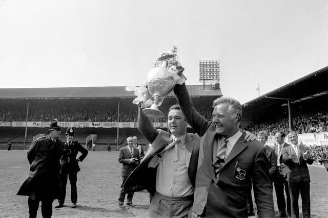 Clough (left) and his assistant Peter Taylor (right) after winning the title in 1972 (PA)
