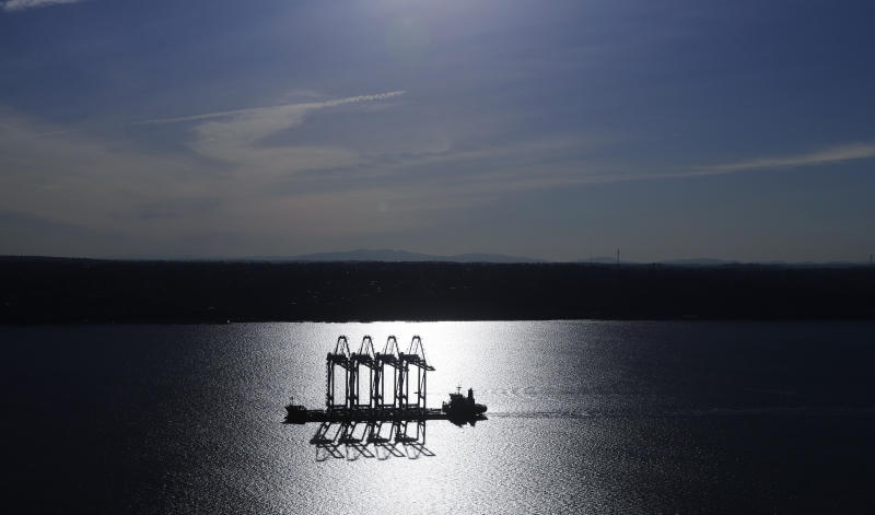 FILE - In this March 5, 2019, file photo the Zhen Hua 31 heavy-lift ship carrying four super-post-Panamax container cranes is silhouetted by the sun as it sails into Commencement Bay in Tacoma, Wash. As world leaders gather for their annual meeting at the United Nations this week, the AP takes a look at some of the issues brewing in the background that are contributing to tensions between countries. (AP Photo/Ted S. Warren, File)
