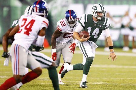 Aug 24, 2018; East Rutherford, NJ, USA; New York Jets quarterback Sam Darnold (14) rushes for a first down against the New York Giants during first half at MetLife Stadium. Mandatory Credit: Noah K. Murray-USA TODAY Sports