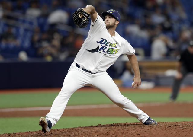 Tampa Bay Rays relief pitcher Colin Poche delivers to the Detroit Tigers during the 13th inning of a baseball game Saturday, Aug. 17, 2019, in St. Petersburg, Fla. (AP Photo/Chris O'Meara)