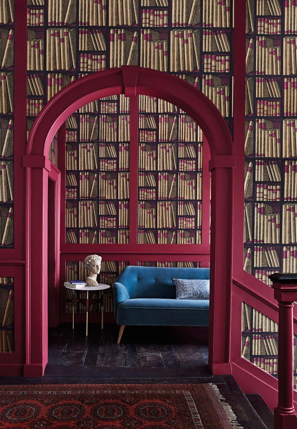 """<p>If you yearn for a library or just love this quirky design, it's been used here to great effect. Using it on the near and far walls leads you in, and it is complemented perfectly with the deep pink woodwork which echoes the spines on the 'books'.</p><p>Top Tip: It would be great in a small space too.</p><p>Pictured: Fornasetti Senza Tempo Ex Libris wallpaper, <a href=""""https://www.cole-and-son.com/en/products/ex-libris-1?v=3861"""" rel=""""nofollow noopener"""" target=""""_blank"""" data-ylk=""""slk:Cole & Son"""" class=""""link rapid-noclick-resp"""">Cole & Son</a></p>"""