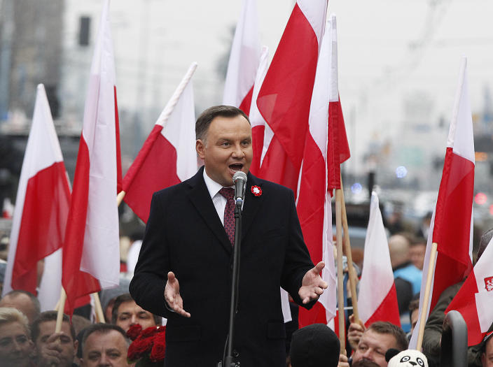 Poland's President Andrzej Duda speaks at the start of a massive march marking 100 years since Poland regained independence in Warsaw, Poland, Sunday, Nov. 11, 2018. Poland's president, prime minister and other top leaders led an Independence Day march Sunday that included members of nationalist organizations, the first time Polish state officials have marched with the far-right groups. (AP Photo/Czarek Sokolowski)