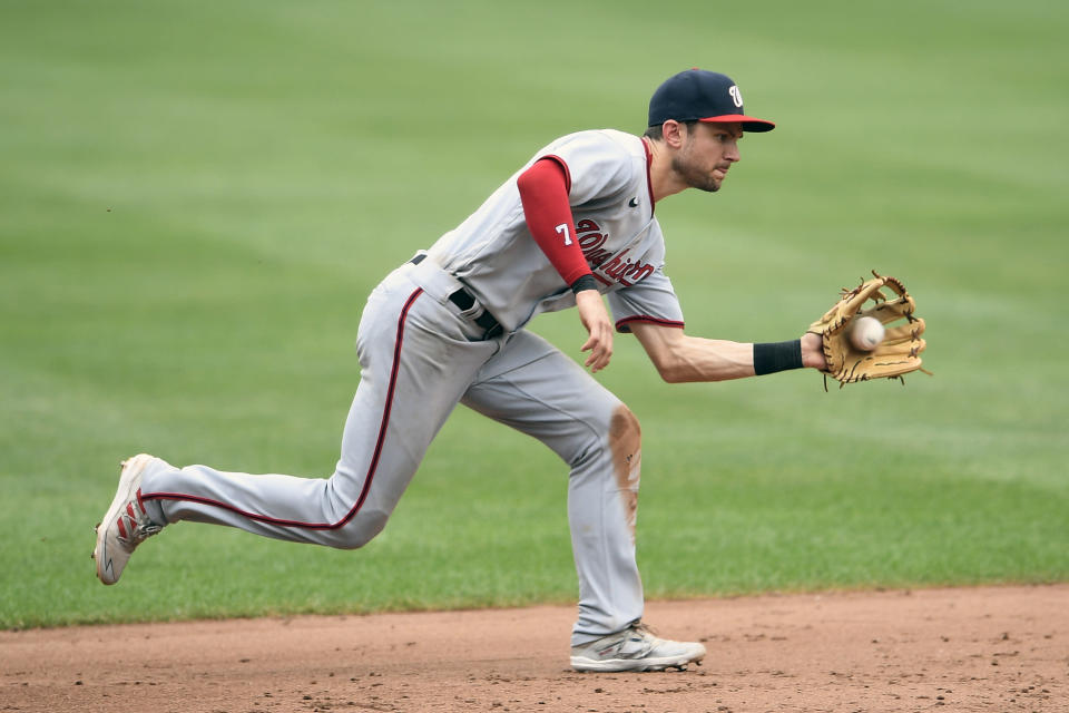 Washington Nationals shortstop Trea Turner fields a grounder by Baltimore Orioles' Trey Mancini during the sixth inning of a baseball game, Sunday, July 25, 2021, in Baltimore. Mancini was out at first on the play. (AP Photo/Nick Wass)