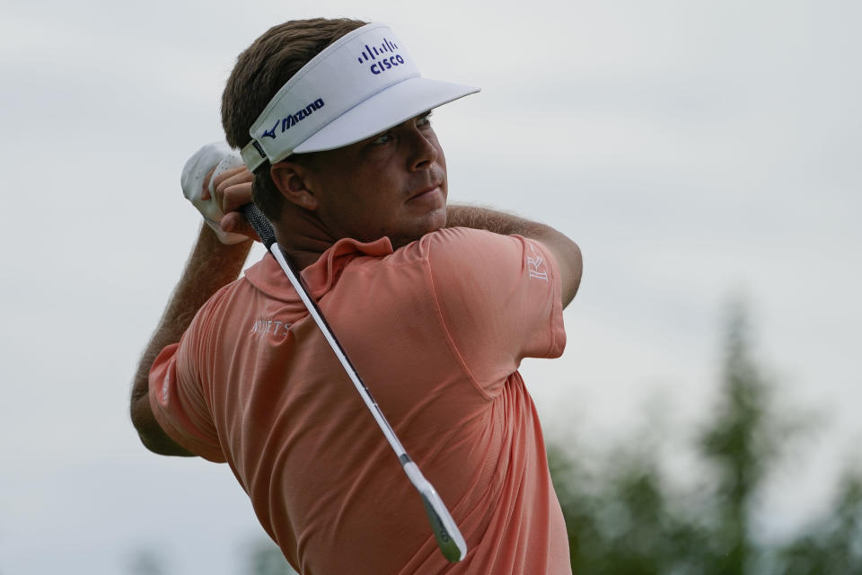 Keith Mitchell watches his shot off the 11th tee in the third round at the Northern Trust golf tournament, Saturday, Aug. 21, 2021, at Liberty National Golf Course in Jersey City, N.J. (AP Photo/John Minchillo)