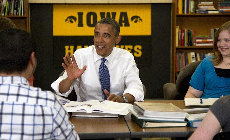 President Barack Obama participates in a roundtable discussion with students at the University of Iowa, Wednesday, April 25, 2012, in Iowa City, Iowa. at right is Myranda Burnett, and left is Martin Lopez. (AP Photo/Carolyn Kaster)