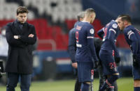 PSG's head coach Mauricio Pochettino stands on the touchline during the French League One soccer match between Paris Saint-Germain and Brest at the Parc des Princes in Paris, Saturday, Jan. 9, 2021. (AP Photo/Francois Mori)