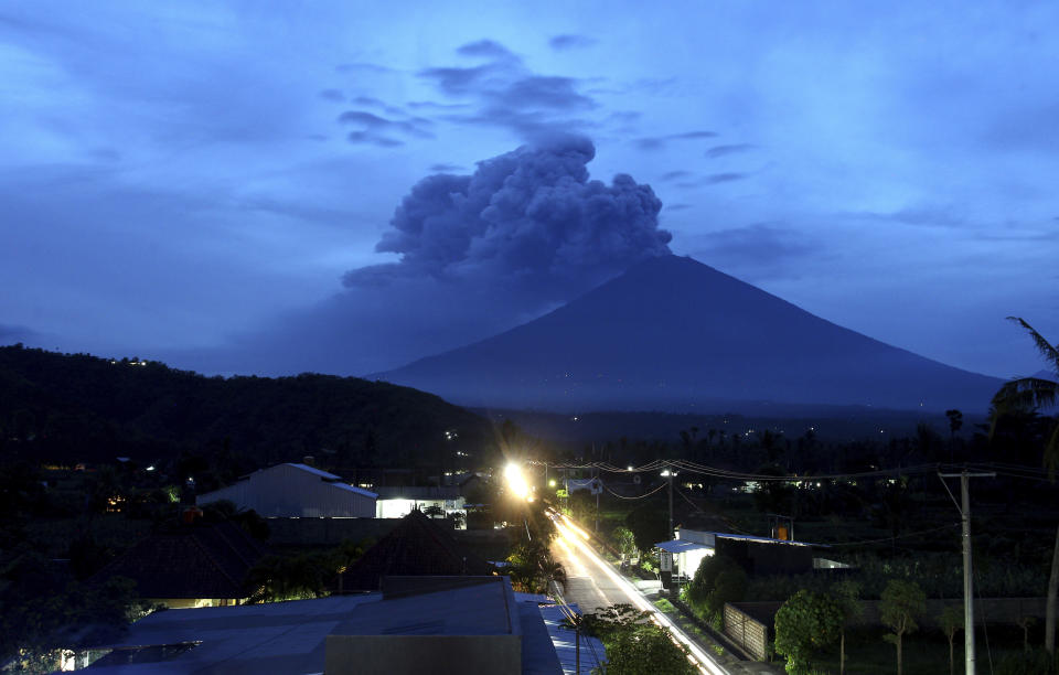 <p>A view of Mount Agung volcano erupting in Karangasem, Bali, Indonesia, Nov. 28, 2017. Indonesia authorities raised the alert for the rumbling volcano to highest level on Monday and closed the international airport on tourist island of Bali stranding thousands of travelers. (Photo: Firdia Lisnawati/AP) </p>