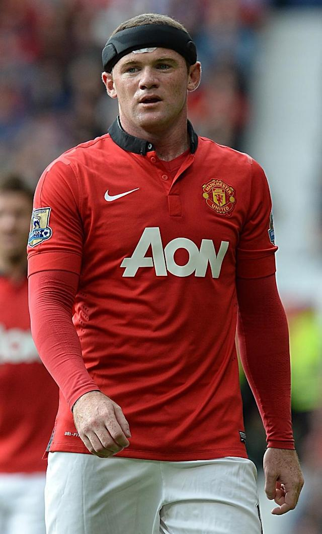 Manchester United's Wayne Rooney wears a headband to protect an injury during the English Premier League match against CrystalPalace at Old Trafford, Manchester England Saturday Sept. 14, 2013. (AP Photo/ Martin Rickett/PA)