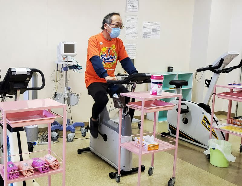 Manabu Yoneshima works out by using bicycle machine in his hospital's rehabilitation room in Tsuruga