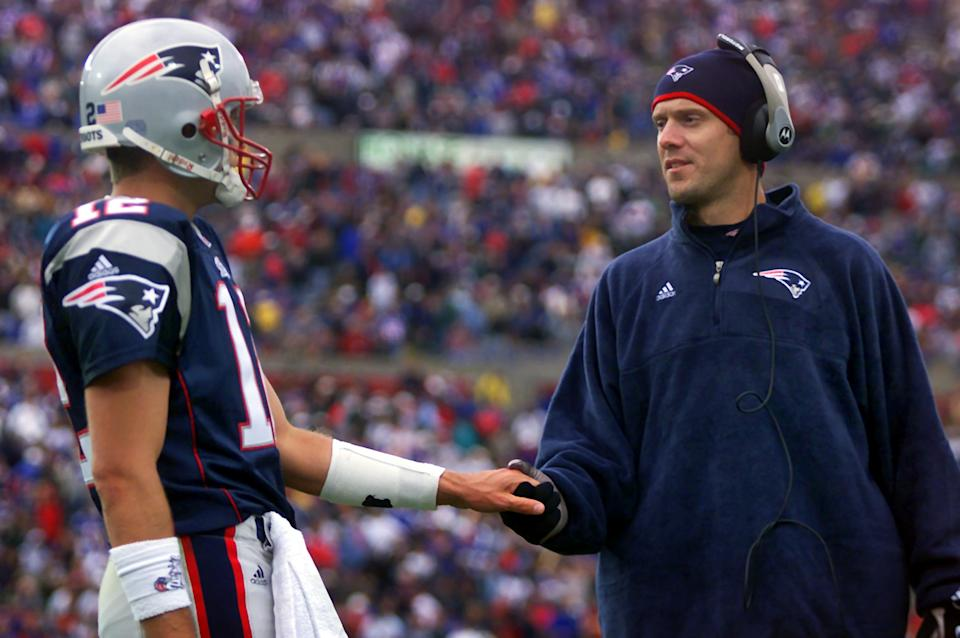 When Patriots starting quarterback Drew Bledsoe (right) was injured early in the 2001 season, Tom Brady never gave back the job. (Photo by Jim Davis/The Boston Globe via Getty Images)