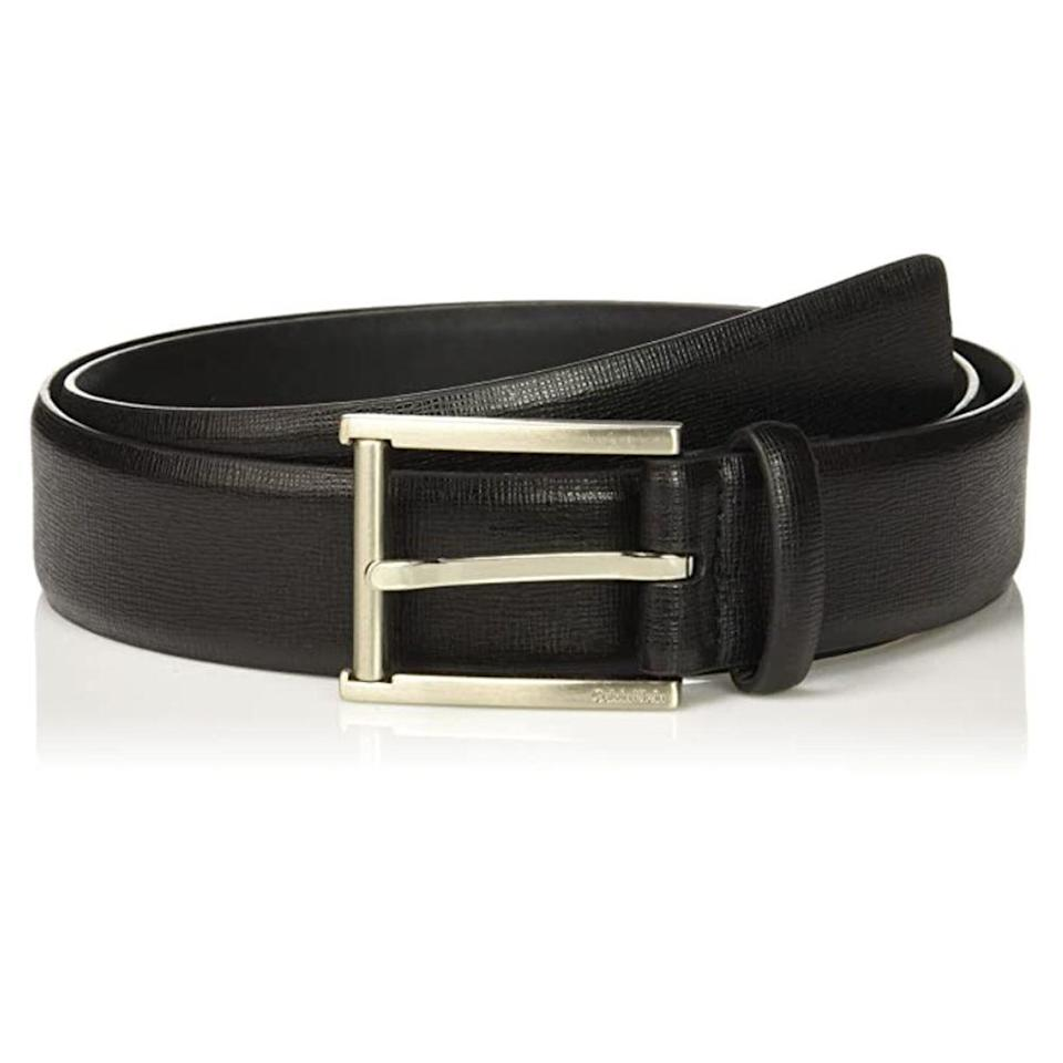 """<p><strong>Calvin Klein</strong></p><p>amazon.com</p><p><strong>$18.93</strong></p><p><a href=""""https://www.amazon.com/dp/B01N9EXPRI?tag=syn-yahoo-20&ascsubtag=%5Bartid%7C2139.g.36521961%5Bsrc%7Cyahoo-us"""" rel=""""nofollow noopener"""" target=""""_blank"""" data-ylk=""""slk:BUY IT HERE"""" class=""""link rapid-noclick-resp"""">BUY IT HERE</a></p><p>Looking for something simple and classic? Go for this Calvin Klein feather-edge belt, which features a subtle textured pattern that'll elevate even the most basic of ensembles. </p>"""