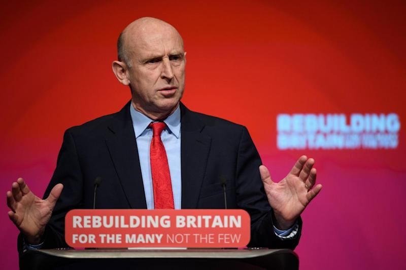 Shadow Housing Secretary John Healey addresses delegates at the annual Labour Party conference in Liverpool. (Getty/Leon Neal)