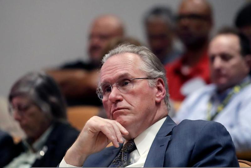 Pacific Gas and Electric CEO Bill Johnson listens to speakers during a California Public Utilities Commission meeting in San Francisco.