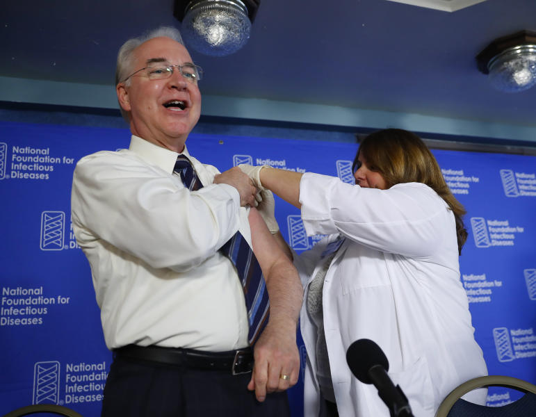 Health and Human Services Secretary Tom Price, left, receives a flu vaccination from Sharon Walsh-Bonadies, RN., right during a news conference recommending everyone age six months an older be vaccinated against influenza each year, Thursday, Sept. 28, 2017 in Washington. (AP Photo/Pablo Martinez Monsivais)