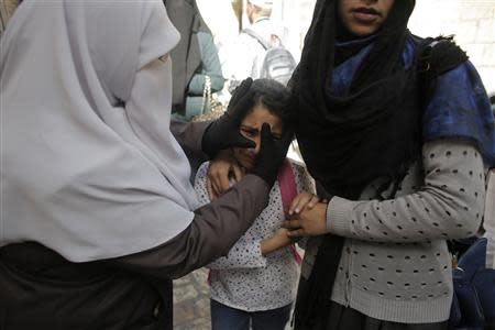 A Palestinian girl reacts after her mother was involved in scuffles with Israeli policemen as the police prevented people from entering the compound which houses al-Aqsa mosque and is known to Muslims as Noble Sanctuary and to Jews as Temple Mount, in Jerusalem's Old City April 16, 2014. REUTERS/Ammar Awad