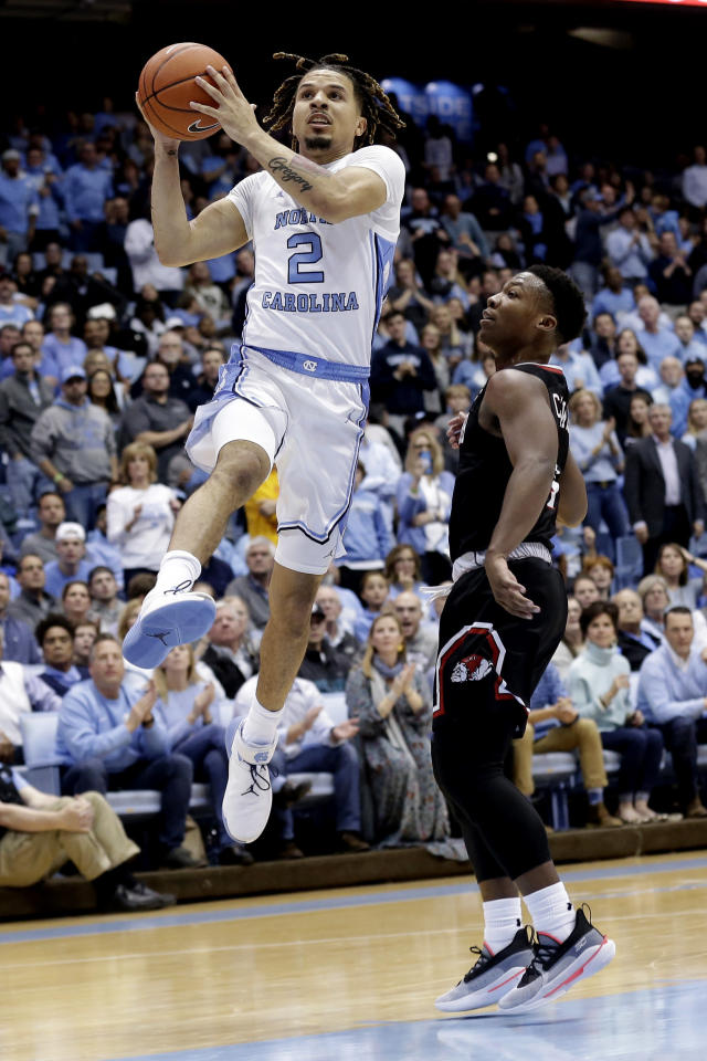 North Carolina guard Cole Anthony (2) drives to the basket while Gardner-Webb guard Jaheam Cornwall defends during the first half of an NCAA college basketball game in Chapel Hill, N.C., Friday, Nov. 15, 2019. (AP Photo/Gerry Broome)