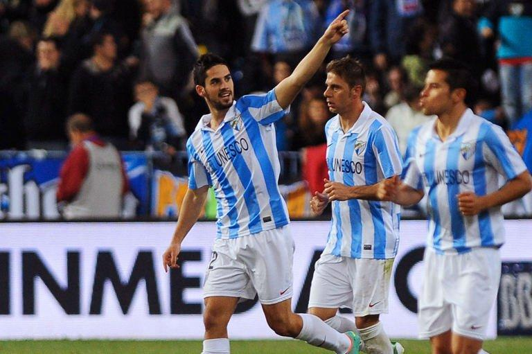 Malaga's midfielder Isco (L) celebrates after scoring in Malaga on December 22, 2012