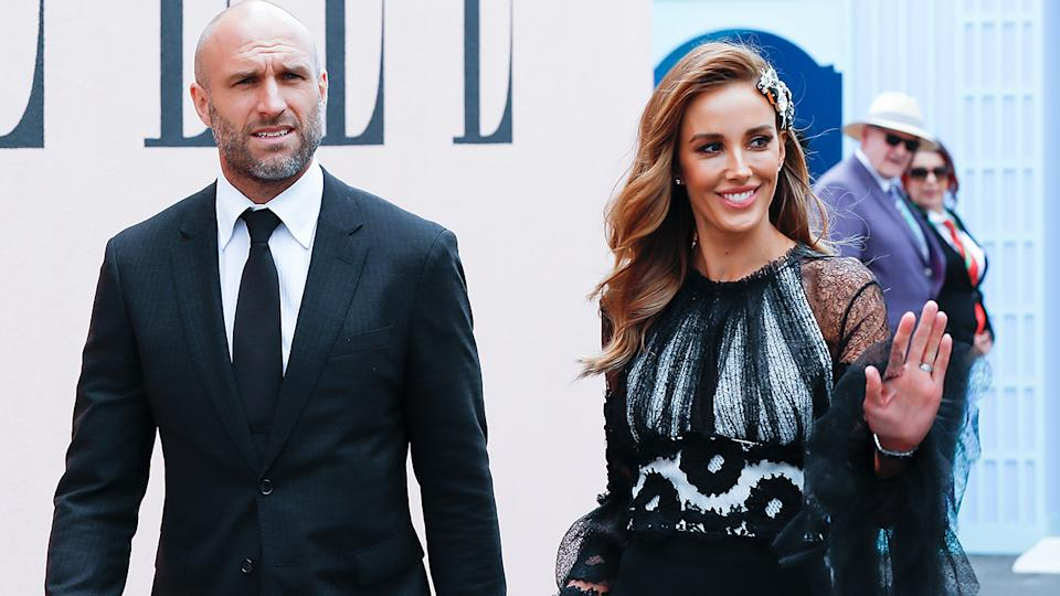 Chris and Rebecca Judd, pictured here at Derby Day at Flemington Racecourse in 2018.