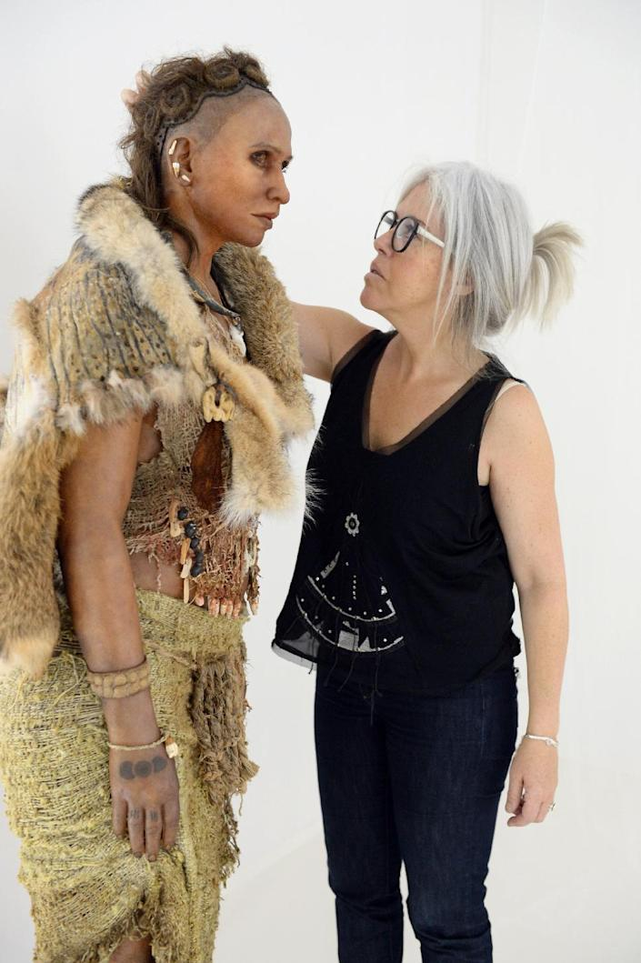 """Visual artist Elisabeth Daynes stands next to a reconstruction of """"The woman from the Pataud Shelter"""" on November 7, 2014 in Bordeaux (AFP Photo/Mehdi Fedouach)"""