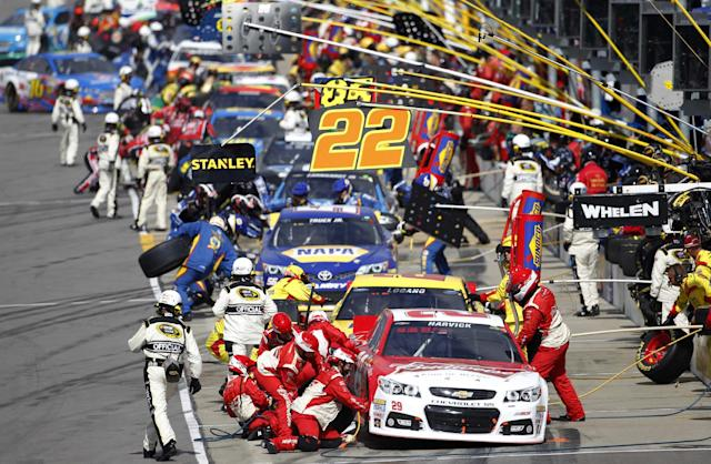 Driver Kevin Harvick (29) leads teams on pit row during a NASCAR Sprint Cup series auto race at Kansas Speedway in Kansas City, Kan., Sunday, Oct. 6, 2013. (AP Photo/Colin E. Braley)