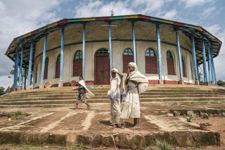 Ethiopian Orthodox devotees stand outside a church in Anderacha, once the site of a palace of the Kaffa kingdom near the town of Bonga in southern Ethiopia (AFP/EDUARDO SOTERAS)
