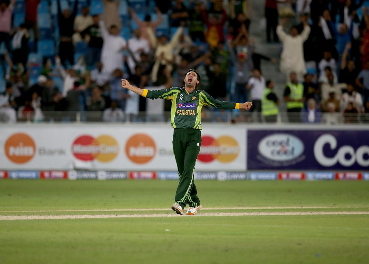 DUBAI, UNITED ARAB EMIRATES - DECEMBER 20:  Junaid Khan of Pakistan celebrates after dismissing Thisara Perera of Sri Lanka during the second One-Day International (ODI ) match between Sri Lanka and Pakistan at the Dubai Sports City Cricket Stadium on December 20, 2013 in Dubai, United Arab Emirates.  (Photo by Francois Nel/Getty Images)