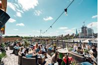 """<p>Found in Wapping's Tobacco Dock, with impressive panoramic views of the City is <a href=""""https://www.tobaccodocklondon.com/skylight/"""" rel=""""nofollow noopener"""" target=""""_blank"""" data-ylk=""""slk:Skylight"""" class=""""link rapid-noclick-resp"""">Skylight</a>.</p><p> In preparation for the 2021 summer opening, the venue has allocated even more space on its rooftop for tables. Guests will need to have a booking in advance to secure entry and table service will continue at the venue. </p><p>Corona lager's colourful beer terrace will return as will games like croquet and Pétanque. Food wise there are offerings from Hikari and State Side with a new seasonal cocktail menu planned to. The Quayside Cocktail Cinema Experience and 'Dog Day' are some of the events the space plans to host when permitted too.</p>"""