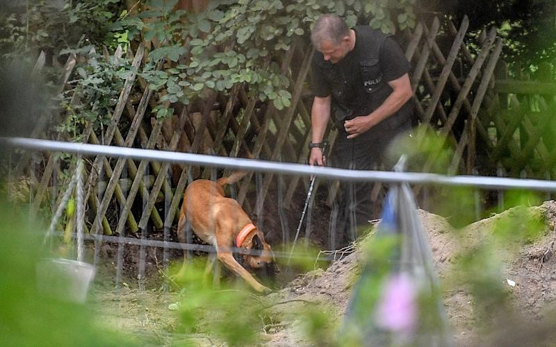 Police use sniffer dogs at the site - AP