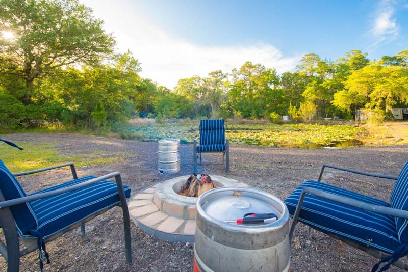 Outside, guests can enjoy a fire pit with keg end tables or cook on the grill -- a good thing, since there is no kitchen, oven or even a stovetop in the man cave. Photo credit: Airbnb.