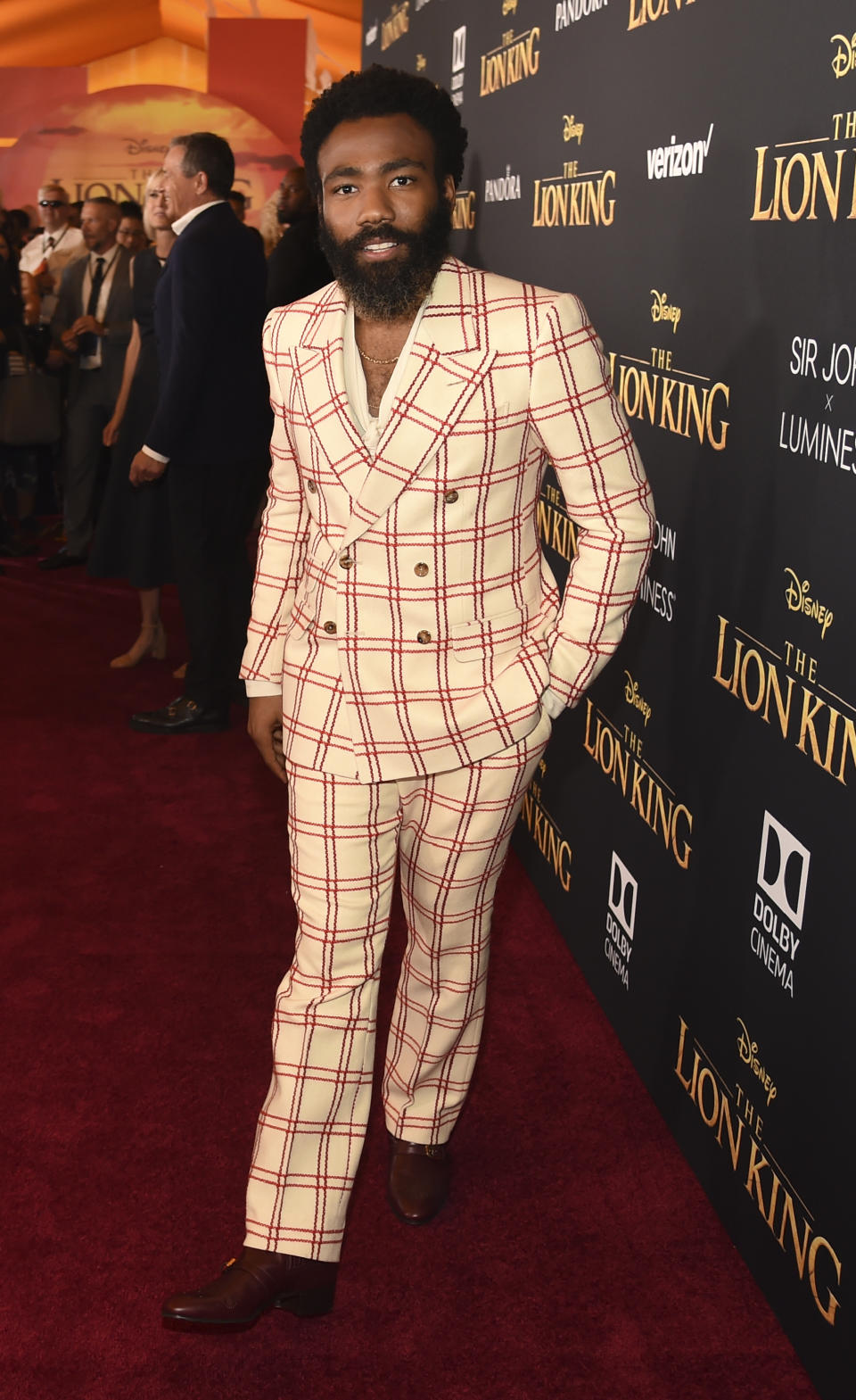 """Donald Glover, a cast member in """"The Lion King,"""" arrives at the premiere of the film, Tuesday, July 9, 2019, in Los Angeles. (Photo by Chris Pizzello/Invision/AP)"""