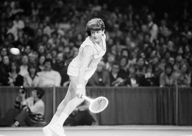FILE - In this Feb. 13, 1977, file photo, Margaret Court of Australia hits a backhand shot against Chris Evert of Fort Lauderdale, in the finals of the $100,000 Virginia Slims tennis tournament in Chicago. Tennis Australia said Saturday, Nov. 30, 2019, it plans to honor Margaret Courts 50th anniversary of her 1970 Grand Slam during Januarys Australian Open, but stressed her controversial anti-gay views do not align with our values of equality, diversity and inclusion.(AP Photo/Larry Stoddard, File)