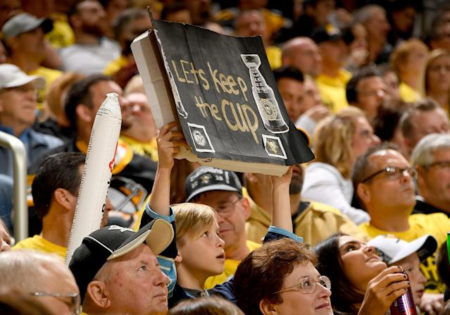 <p>A young Penguins fan hold up a sign against the Columbus Blue Jackets in Game Two of the Eastern Conference First Round during the 2017 NHL Stanley Cup Playoffs at PPG Paints Arena on April 14, 2017 in Pittsburgh, Pennsylvania. (Photo by Joe Sargent/NHLI via Getty Images) </p>
