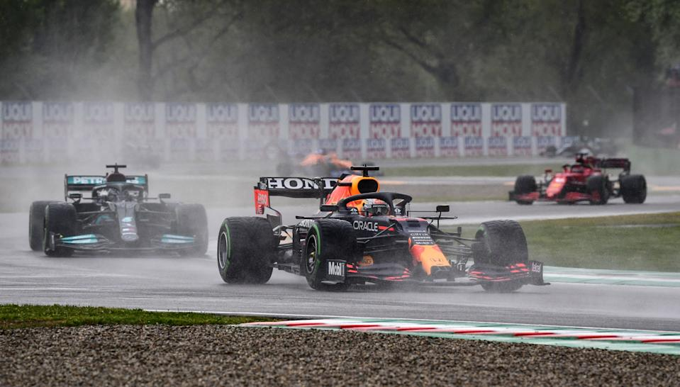 Red Bull's Dutch driver Max Verstappen (C) drives ahead of Mercedes' British driver Lewis Hamilton (L) and Ferrari's Monegasque driver Charles Leclerc (R) during the Emilia Romagna Formula One Grand Prix at the Autodromo Internazionale Enzo e Dino Ferrari race track in Imola, Italy, on April 18, 2021. (Photo by Miguel MEDINA / AFP) (Photo by MIGUEL MEDINA/AFP via Getty Images)